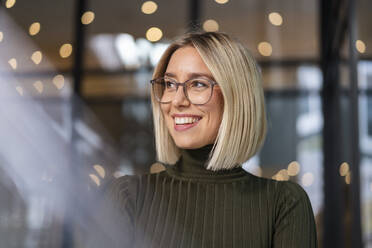 Portrait of happy young woman in the city - DIGF08720