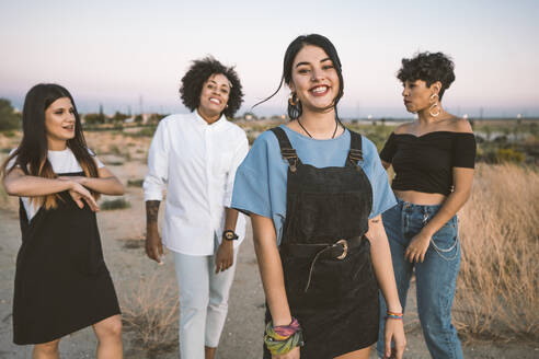 Smiling women posing in countryside - DAMF00217