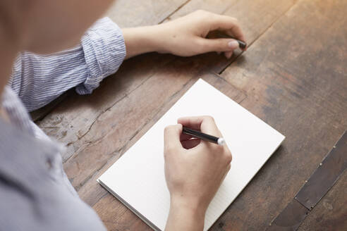 Woman writing on notebook - CUF53083