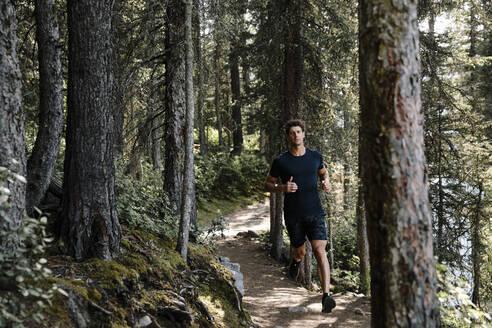 Man jogging in woods - HEROF39769