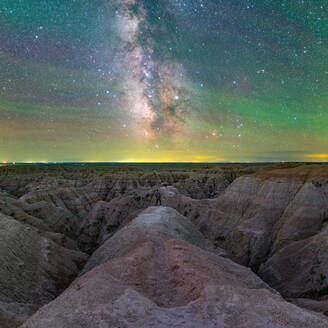 Selfy of man standing on badlands in front of the milky way at night - CAVF66964