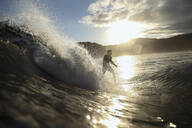 Surfer on a wave at sunset time - CAVF67339