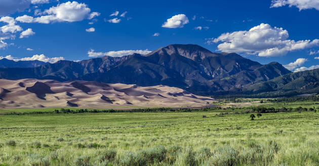 Scenic view of landscape against sky on sunny day - CAVF67849