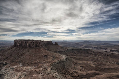 Scenic view of rock formations at Moab against cloudy sky - CAVF68014