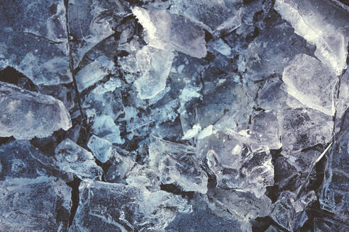 Germany, North Rhine-Westphalia, Wuppertal, Close-up of cracked ice in winter - DWIF01065