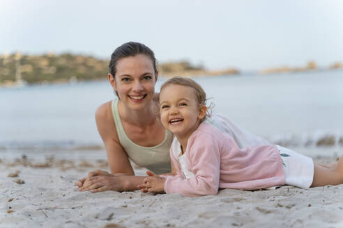 Portrait of happy mother with daughter on the beach - DIGF08741