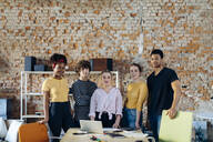 Portrait of confident young people at table in a loft - SODF00128
