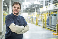 Portrait of confident worker in a modern factory - WESTF24317