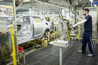 Man working in modern car factory - WESTF24338