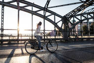 Young cyclist on a bridge at sunset - WFF00142