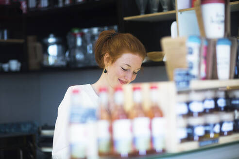 Young woman working in coffee shop - SGF02425