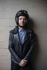 Portrait of young biker wearing - JPIF00238