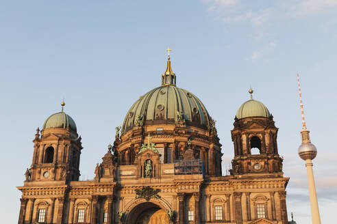 Germany, Berlin, Facade of Berlin Cathedral with Berlin TV Tower in background - GWF06219