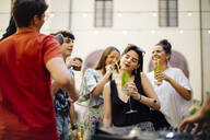 Happy multi-ethnic friends having fun during a party - SODF00165