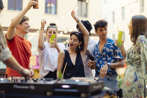 Happy multi-ethnic friends having fun during a party - SODF00168