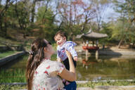 Mother and baby girl visiting the Secret Garden of Changdeokgung Palace, Seoul, South Korea - GEMF03262
