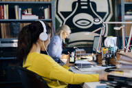 Colleagues working in architect's office, woman having conference call - SODF00204