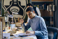 Young man working in architect's office - SODF00207