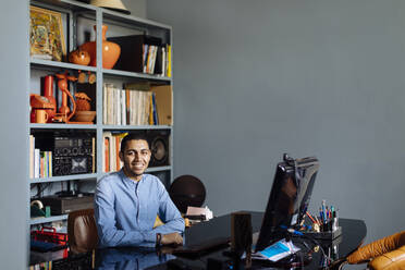 Young designer working in his office - SODF00237