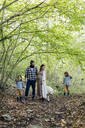 Family with two kids and dog in the forest - SODF00321