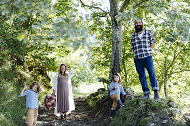 Portait of happy family with two kids in the forest - SODF00342