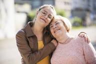 Granddaughter embracing her grandmother - UUF19516