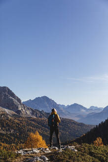 Hiker standing on viewpoint, Dolomites Alps, Veneto, Italy - MCVF00077