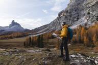 Man hiking at Dolomites Alps, Veneto, Italy - MCVF00080