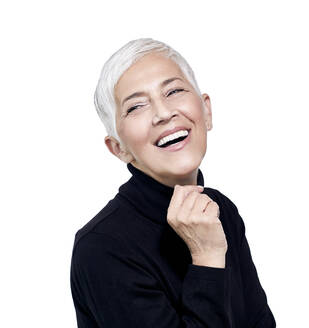 Portrait of laughing mature woman with short grey hair wearing black turtleneck pullover - RAMF00088