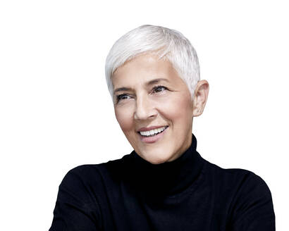 Portrait of mature woman with short grey hair wearing black turtleneck pullover against white background - RAMF00091