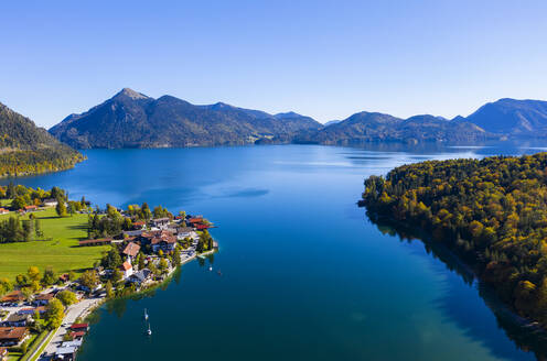 Germany, Bavaria, Upper Bavaria, Aerial view of Walchensee with village Walchensee, Jochberg mountain in background - LHF00753