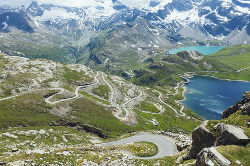 Italy, Piedmont, High angle view of long winding road in GranParadisoNational Park - GIOF07605