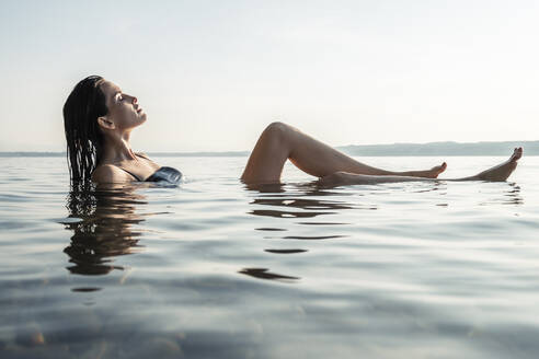 Young woman bathing in Lake Starnberg, Germany - WFF00158