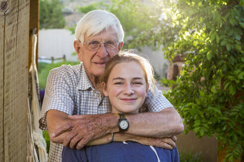 Portrait of A teenage girl and her 83 year old grandfather - MINF12772