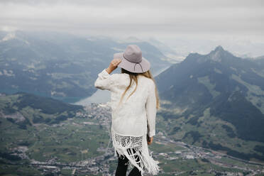 Rear view of woman on viewpoint, Grosser Mythen, Switzerland - LHPF01140