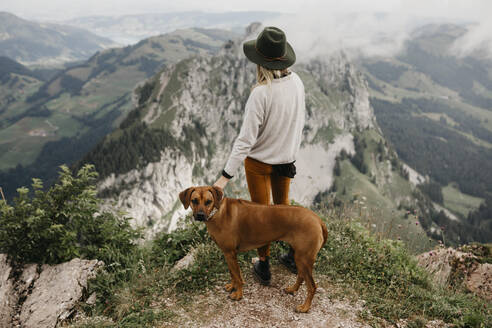 Woman with dog on viewpoint, Grosser Mythen, Switzerland - LHPF01146