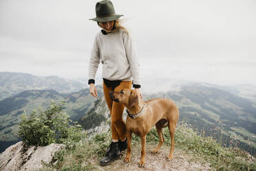 Woman with dog on viewpoint, Grosser Mythen, Switzerland - LHPF01149