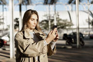 Young blond woman using smartphone and taking a selfie - ERRF02006