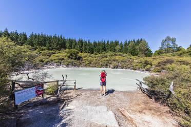 Female tourist at Sulphur Lake, Hell's Gate, Tikitere, Rotorua, North Island, New Zealand - FOF11018