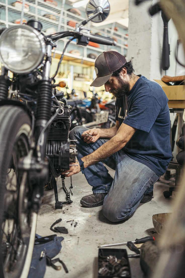 Mechanic In A Repair Garage Repairing A Motorcycle Mtbf00176 Mikel Taboada Westend61