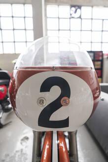 Motorcycle standing in a repair garage - MTBF00179