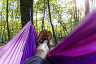 Point of view shot of man lying in hammock in a forest - GEMF03293