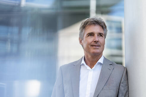 Portrait of confident mature businessman in the city - DIGF08877