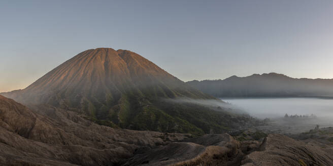 Indonesia, East Java, Aerial panorama of Mount Bromo shrouded in morning fog - TOVF00138