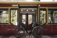 Bicycle at the door of an underground train, Berlin, Germany - AHSF01195