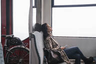 Young woman with closed eyes relaxing on a subway - AHSF01222