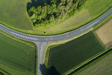 Germany, Bavaria, Aerial view of green fields along countryside highway in spring - RUEF02378