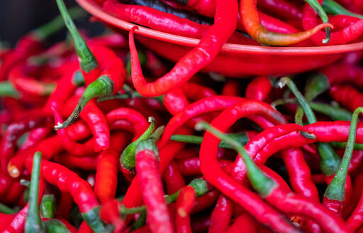Hot fresh red chilies for sale at market, Togian Islands, Indonesia, Southeast Asia, Asia - RHPLF12801
