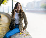 Young brunette woman using smartphone in Verona, Italy - GIOF07729