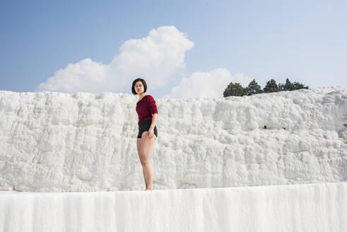 Woman enjoying cotton castle, Pamukkale, Denizli, Turkey - CUF53491